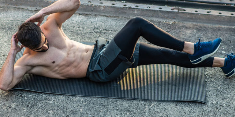 Male performing ab workouts