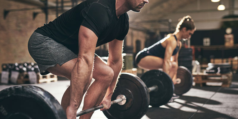 Male performing deadlift